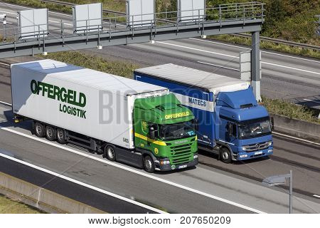 Frankfurt Germany - Sep 19 2017: Scania G410 and Mercedes Benz Atego trucks on the highway in Germany