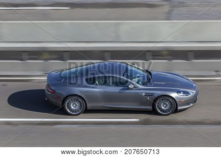 Frankfurt Germany - Sep 19 2017: Aston Martin Vanquish supercar driving on the highway in Germany