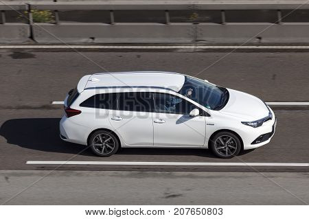 Frankfurt Germany - Sep 19 2017: White Toyota Auris Touring Sports Hybrid driving on the highway in Germany