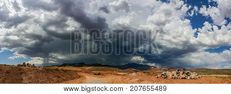 Ominous Stormy Sky and Cumulus Clouds with Rain Pano in the Desert.
