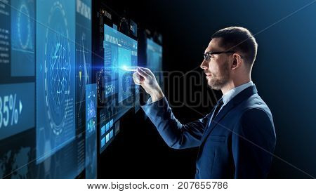 business, people, augmented reality and future technology concept - businessman in glasses with virtual screens projection over black background