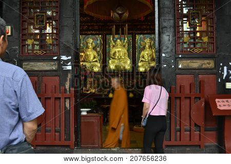 Buddhist Monks Doing A Ritual By Walking. He Did Circumambulation Around The Altar