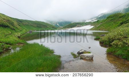 pond on mountaintop Tateyama Kurobe Alpine Japan