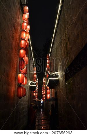 People Doing Photography Shoot In The Alley Full Of Lanterns. Location: Jinli Ancient Street Of Chen