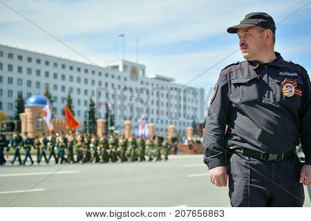 Yoshkar-Ola, Russia - May 9, 2015 Photo of a Russian police officer standing in cordon during the solemn victory parade in Yoshkar-Ola, Russia
