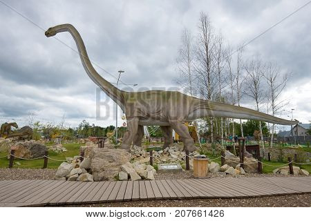 KIROV, RUSSIA - AUGUST 30, 2017: Sculpture herbivorous dinosaur Mamenchisaurus cloudy by day. Paleontological children's Park