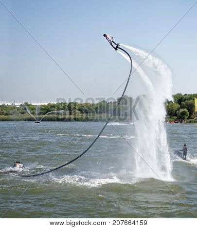 Rostov-on-Don Russia- September 162017: The athlete flies with a water jet from the side of a water motorcycle in front of the audience at the celebration of the day of the city of Rostov-on-Don