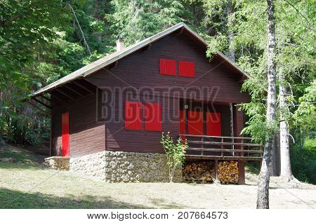 Mountain Lodge With Red Windows