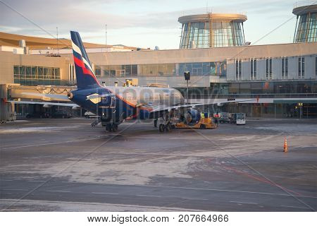 ST PETERSBURG, RUSSIA - JANUARY 07, 2017: Airbus A320 of Aeroflot airline on service at Pulkovo airport on a winter evening
