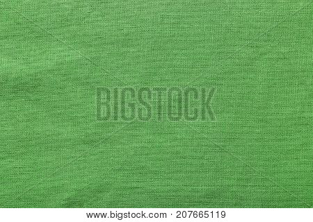Green burlap background and texture The texture of the burlap closeup