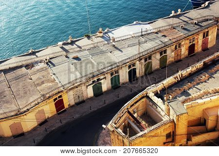 Panoramic skyline view of ancient defences of Valletta and the Grand Harbor , Malta .