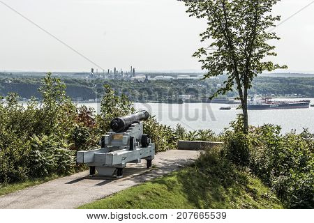 Quebec City Canada 11.09.2017 Cannon in Quebec City Canada - plaines Abraham overlooking Saint Lawrence river and Jean-Gaulin Refinery in Levis town