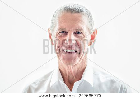 Cheerful senior businessman smiling at camera against white background. Portrait of happy male executive running company. Employer concept