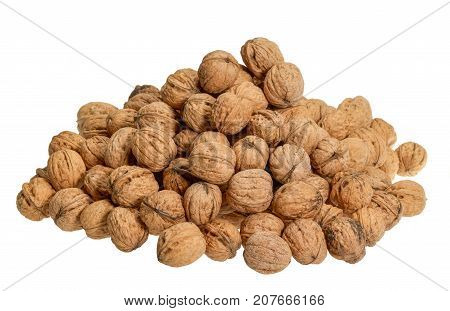 pile of walnuts with nutshell in white back
