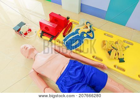 dummy and stretcher in training cpr medical emergency refresher