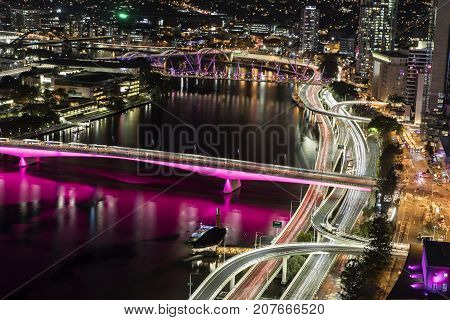 BRISBANE, AUSTRALIA - SEPTEMBER 30 2017: Close up aerial nightscape over Brisbane CBD, with a view of city traffic over Victoria Bridge and Pacific highway entrances into the city including North Quay.