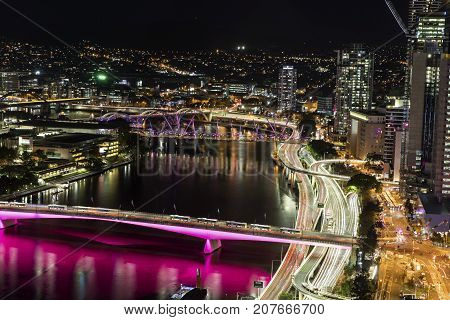 BRISBANE, AUSTRALIA - SEPTEMBER 30 2017: Aerial nightscape over Brisbane CBD, with a view of city traffic over Victoria Bridge and Pacific highway entrances into the city.