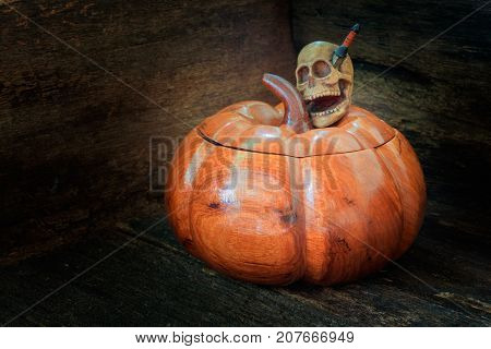 skull on pumpkin made of wood in Halloween day concept background. still life style with copy space add text ( full High definition Photo)