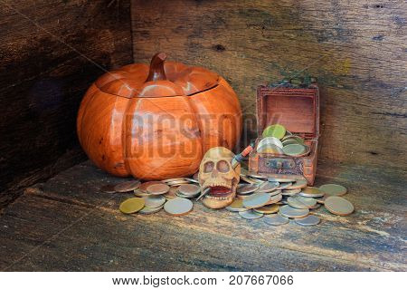 skull on coin in Halloween day concept on old vintage wooden background. still life style with copy space add text ( full High definition Photo)