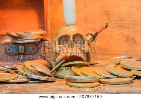 skull on coin have candlelight in Halloween day concept on old vintage wooden background. still life style with copy space add text ( full High definition Photo)