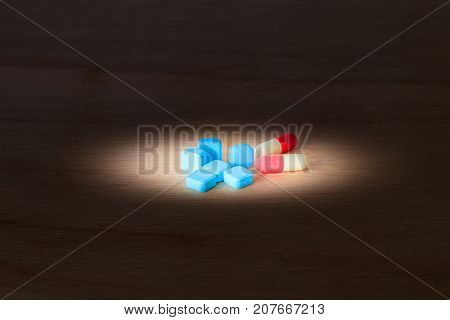 pills blue and capsule On wooden floor with copy space add text ( high definition image )