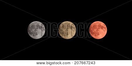 Three colors full moon on black sky background