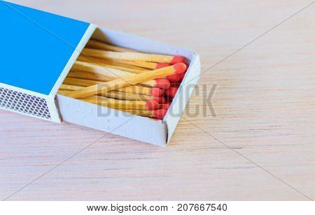 match stick in box with red head concept energy old vintage on wooden floor background with copy space add text ( high definition image )