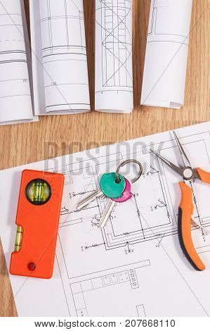 Home Keys With Electrical Drawings Or Blueprints And Orange Work Tools, Concept Of Building Home