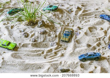 Racing Cars On The Sand Compete Who Is Faster.