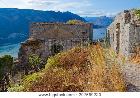 Ruins of ancient fortress (Little Fort) over city of Kotor and Bay of Kotor Montenegro
