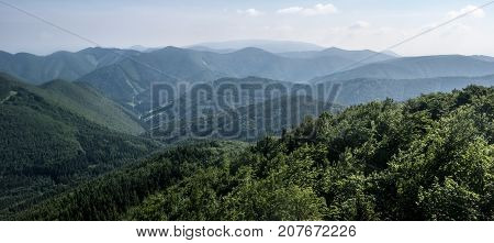 view from Ostra skala hill - hills and valleys of Mala Fatra mountains in Slovakia during nice day with blue sky