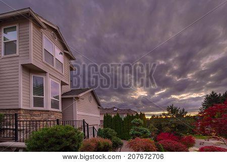 Stormy cky over North American suburbs neighborhood in fall season