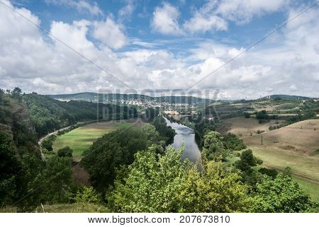 Berounka river with countryside around Beroun city and hills on the background from Tetinska skala rock in Central Bohemia in Czech republic