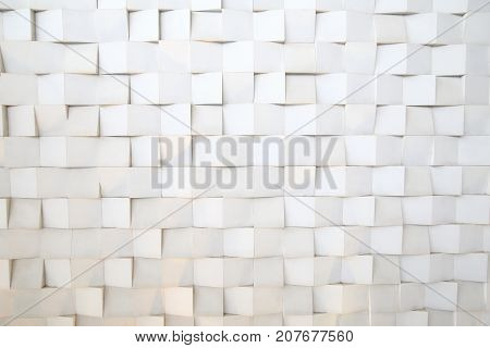 White wall with uneven Square pattern block background.