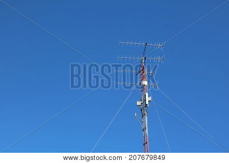 Tower of communication against the blue skyAntenna and telecommunication equipment.