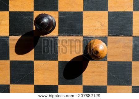 top view Chess Bishops stand on chessboard with shadows