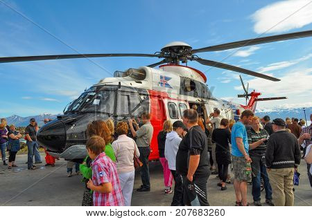 Dalvik Iceland - August 7. 2010: People looking at Icelandic coastguard helicopter TF-LIF