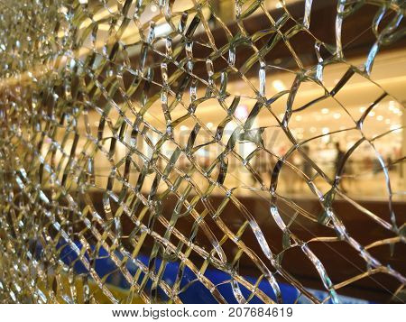 broken glass barrier in a morden shopping mall selective focus