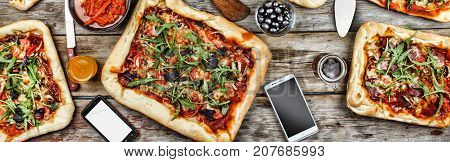 Appetizing Homemade Pizza On A Wooden Table. Friendly Feast At Home.