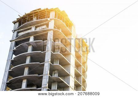 Concrete high storey building frame under construction. Soft light effect