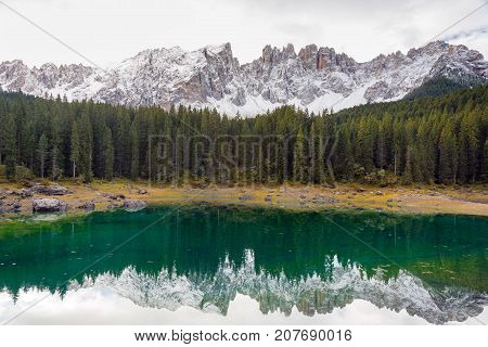 Reflection of the Latemar moutan range at Lake Karer South Tyrol Italy