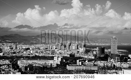 Barcelona, Spain. Aerial view of Barcelona with sea and mountains at the background. Skyscrapers in Barcelona, Spain. Black and white