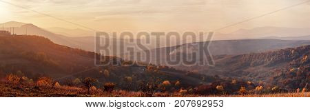 Mountain Autumn Sunset Panorama Landscape With Colorful Forest