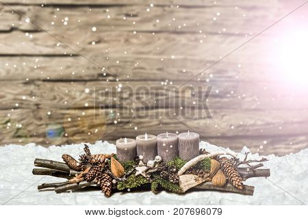 Merry Christmas decoration advent with burning grey candle Blurred background snow text space message 2nd