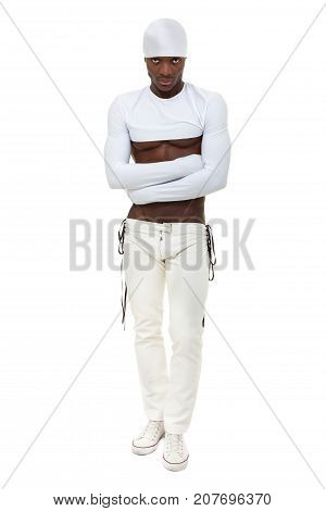 Muscular sexy man dancing, full length portrait isolated on white background.