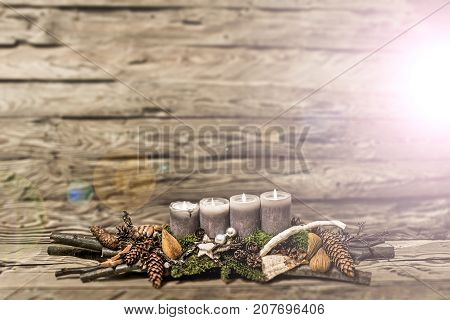 Merry Christmas decoration advent with burning grey candle Blurred background text space message 4th