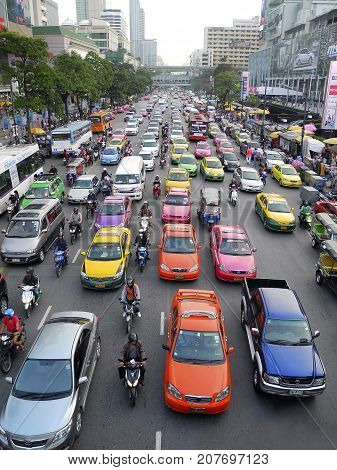 Bangkok, Thailand: October 2, 2012: Seven rows of traffic with motorbikes in between, gridlocked in Bangkok City. Bangkok's rapid growth has put a large strain on infrastructure,