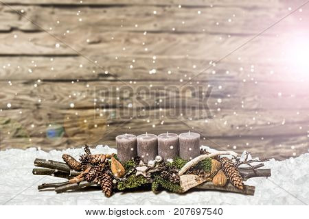 Merry Christmas decoration advent with burning grey candle Blurred background snow text space message