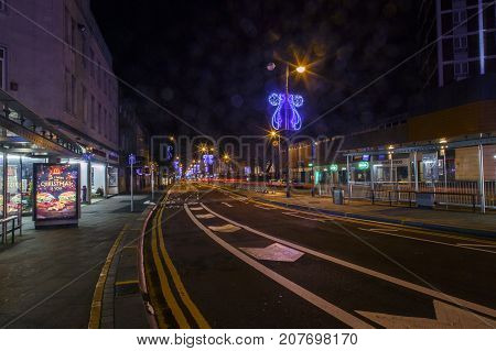 Swansea, Wales, UK: December 7, 2015: Swansea's main street at night. Officially known as the City and County of Swansea is a coastal city and county in Wales second only to Cardiff in size.