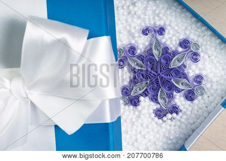 Purple Handmade Paper Snowflake Surrounded By Styrofoam Balls Inside It. Close Shot.